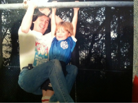 Dad and I hanging from swingset